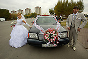 Wedding photos. Bride and groom with Mercedes.