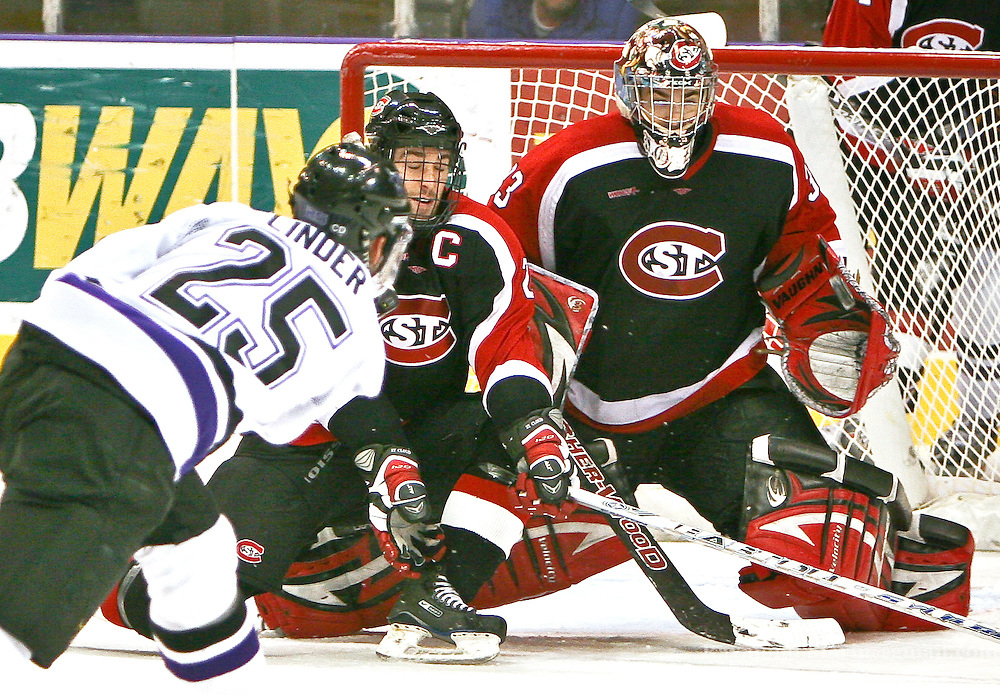 MSU Maverick Ron Linder fires a shot in glove side and scores as Saint Cloud State goalie Jase Weslosky misses.