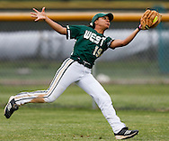 Taleah Smith of Iowa City west catches a fly out in the bottom of the sixth inning at a softball game at Prairie High School in Cedar Rapids on Thursday, May 26, 2016. West High won the first game of their double header against Prairie 8-3.