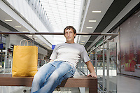 Young man sits in new shopping centre Voronezh