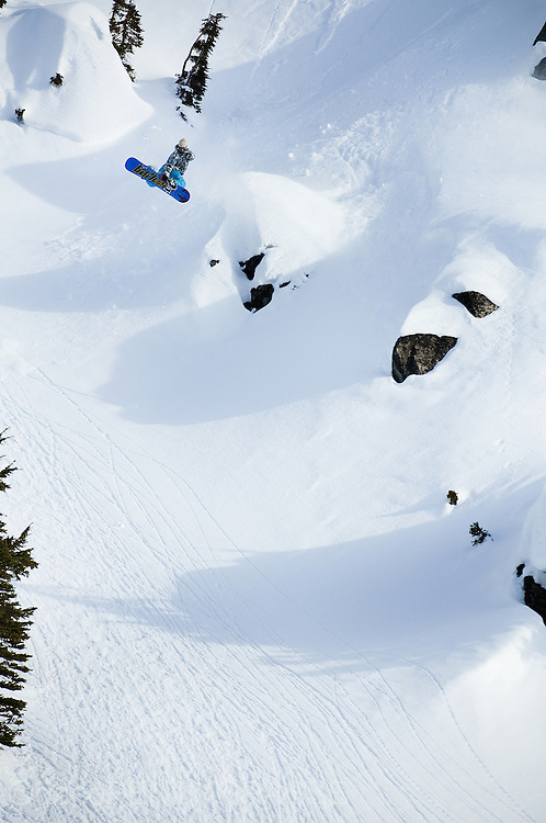 Snowboarder Mark Landvik blasts a Method air off a natural terrain feature in the Backcountry around Terrace, BC, Canada.