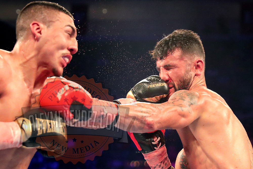 NEW ORLEANS, LA - JULY 14:  Teofimo Lopez lands a straight left to the face of William Silva during their WBC Continental Americas Title boxing match at the UNO Lakefront Arena on July 14, 2018 in New Orleans, Louisiana.  (Photo by Alex Menendez/Getty Images) *** Local Caption *** Teofimo Lopez; William Silva