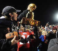 Mississippi linebacker Keith Lewis (24) holds aloft the Golden Egg following the game against Mississippi State at Vaught Hemingway Stadium in Oxford, Miss. on Saturday, November 24, 2012. Mississippi won 41-24. (AP Photo/Oxford Eagle, Bruce Newman).