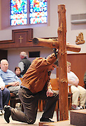 Catholics venerate the cross during a Good Friday service at St. Patrick Church in Menasha, Wis. (Photo by Sam Lucero)