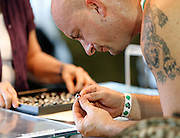 Jason Dullea of Rochester looks at a ring for sale at the Rochester Irish Festival on Friday, September 5, 2014.