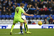 Birmingham City midfielder Jon Toral  plays the ball away from Huddersfield Town defender Martin Cranie during the Sky Bet Championship match between Birmingham City and Huddersfield Town at St Andrews, Birmingham, England on 5 December 2015. Photo by Alan Franklin.