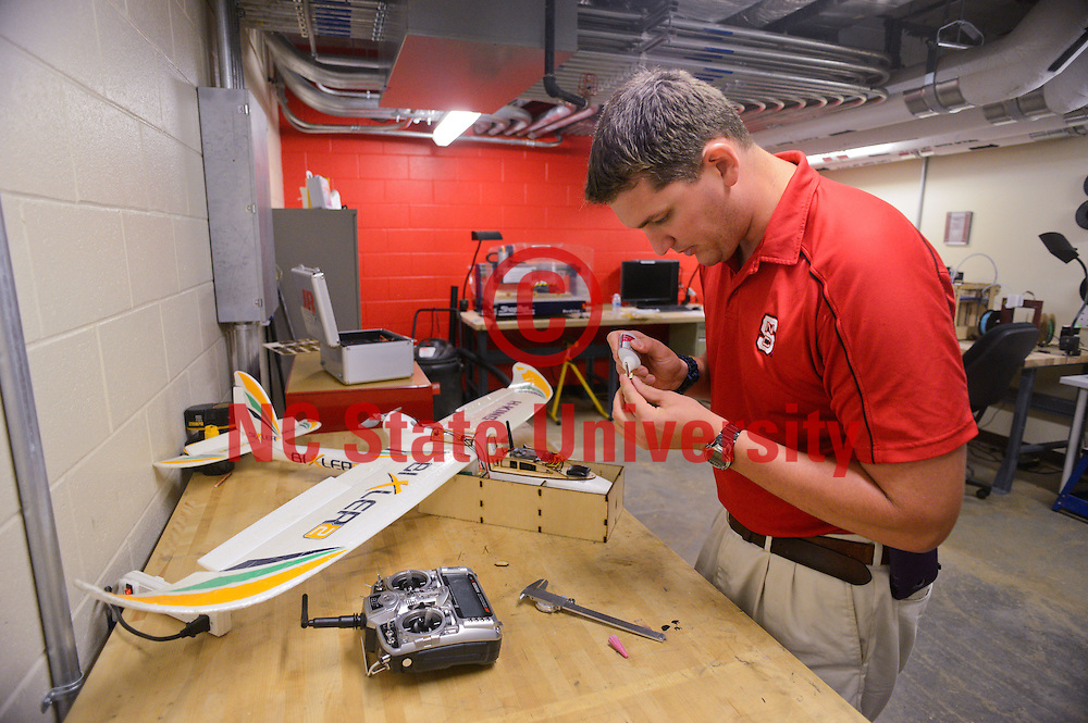 Graduate student Brett Pearce works in the innovation hall garage. He works in RC planes and aeronautics. Photo by Marc Hall