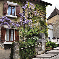 Cottage on Mount Semnoz in Annecy, France <br /> This attractive cottage is typical of the French residences you will find on Mount Semnoz rising about 4,000 feet above the town of Annecy, France. Since a fort was first built at this location in the 8th century, this promontory played a key defensive role for centuries as evident by the Annecy Castle in the background. This mountain also served as Stage 20 in the 2013 Tour de France.