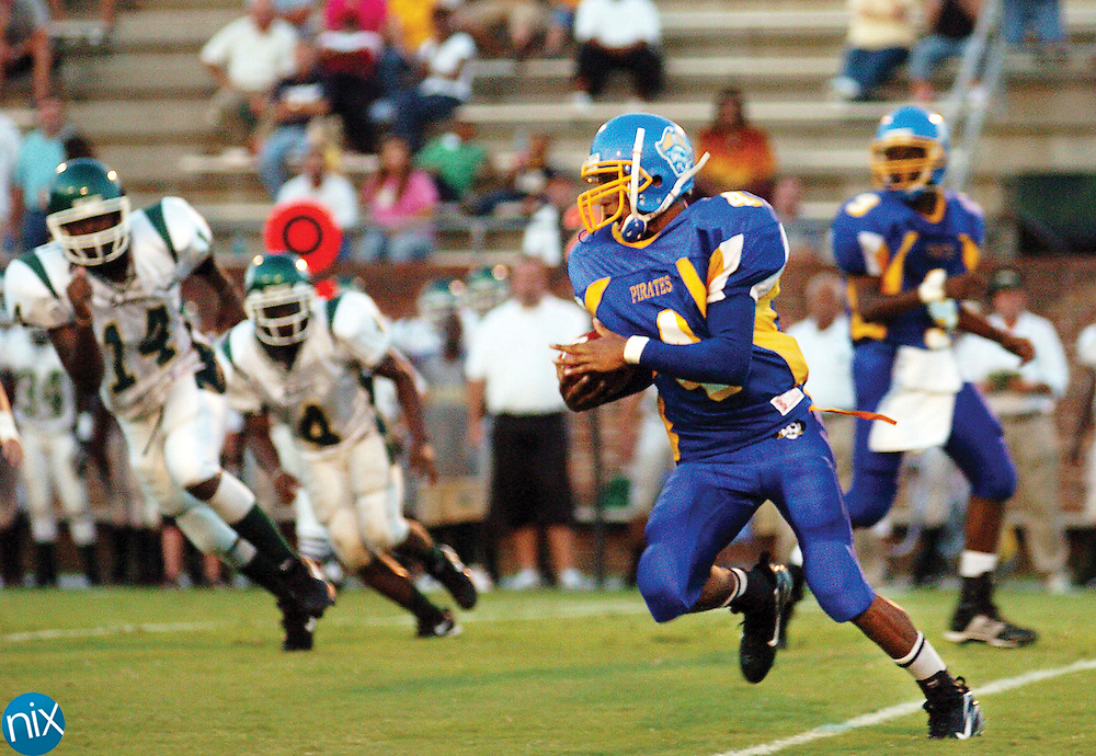 Brunswick High School runningback Darius Slay runs the ball against Ware County Friday night at Glynn County Stadium. Ware beat the Pirates 25-13 in the season opener for both teams.