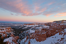 Hoodoo rock formations and snow at sunset, Bryce Amphitheater, Bryce Canyon National Park, Utah, United States of America