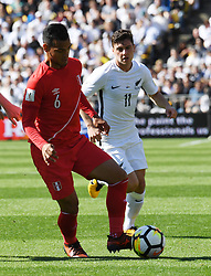 Peru's Miguel Trauco, left, plays in front of New Zealand's Marco Rojas in the Soccer World Cup qualifying match, Westpac Stadium, Wellington, New Zealand, Saturday, November 11, 2017. Credit:SNPA / Ross Setford  **NO ARCHIVING**