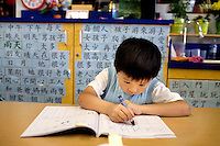 Ryan Luu, 4, a kindergarten student at West Portal Elementary School, works on Chinese characters in the Chinese immersion program, which celebrates the 25th anniversary, in San Francisco, Ca., on Friday, Sept. 11, 2009. Since then, many Chinese programs have opened in the city and the country.