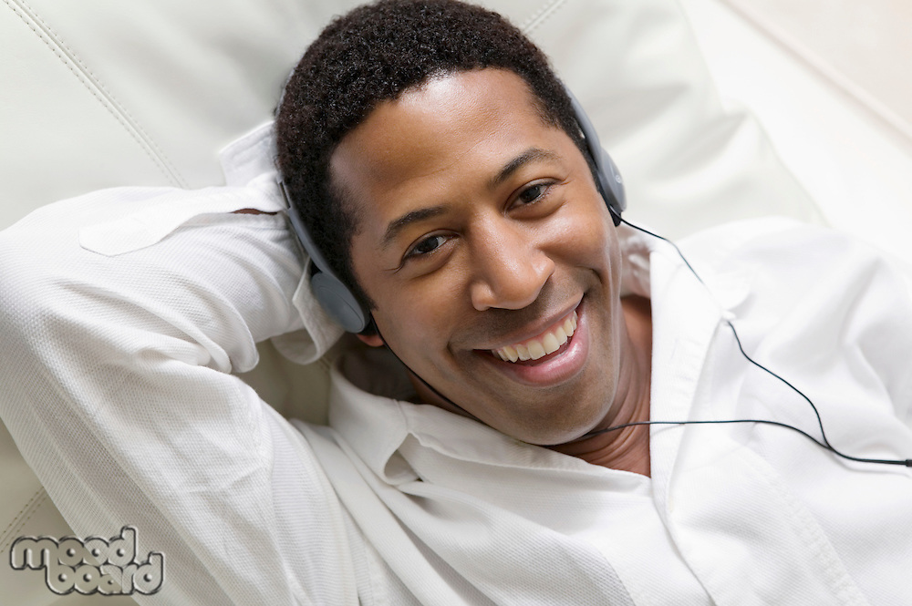 Man Listening to Music on Headphones