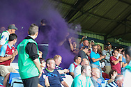 Picture by David Horn/Focus Images Ltd +44 7545 970036<br /> 23/07/2013<br /> Astpn Villa fans let of a purple smoke canister during the Pre Season Friendly match at Kenilworth Road, Luton.