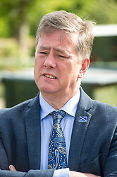 Pictured: Keith Brown<br /> <br /> Cabinet Secretary for Economy, Jobs & Fair Work Keith Brown visited Gorgie City Farm today  to mark their accreditation as the 800th Living Wage employer in Scotland. Mr Brown met Josiah Lockhart, CEO and undertook a short tour of the farm, celebrating their accreditation and promoting the Living Wage more generally. The Scottish Government has set a target of reaching 1,000 Scottish-based Living Wage Accredited Employers by autumn 2017. While at the farm Mr Brown met Maia Gordon, Kirsty McGoff (17) and Zoe White (18), who have benefited from the living wage, and George Ellis, chair of the farm's board of directors<br /> Ger Harley | EEm 18 May 2017