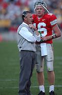 Jim Tressel talks with quarterback Craig Krenzel Oct. 18, 2003 vs. Iowa.