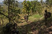 Rangers hike to the top of the Bagunda outpost in Garamba National Park on November 28, 2017.