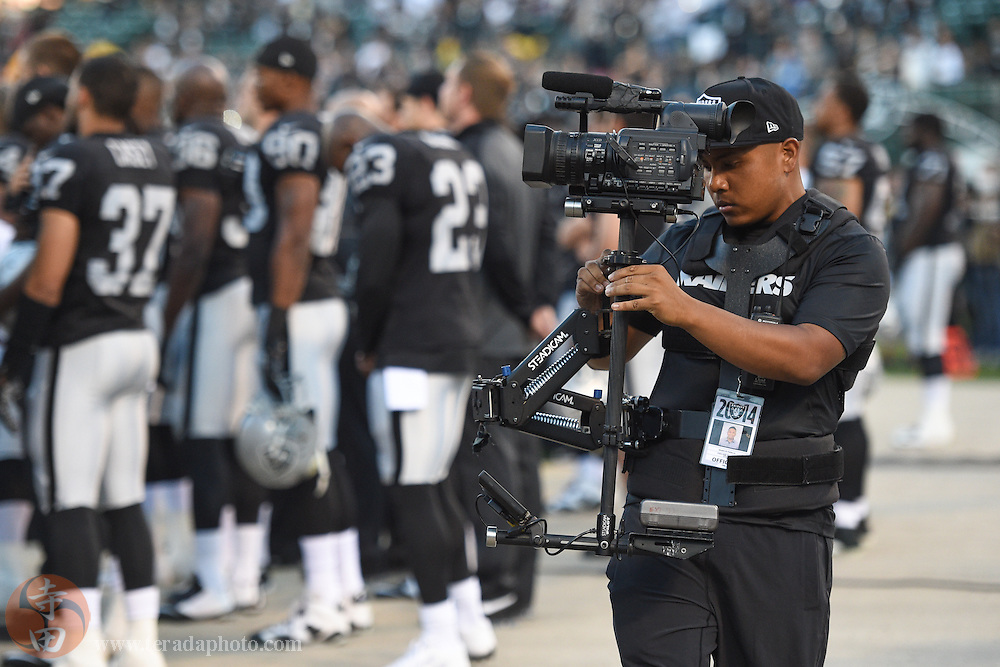 August 15, 2014; Oakland, CA, USA; Oakland Raiders videographers Marcus Padilla before the game against the Detroit Lions at O.co Coliseum. The Raiders defeated the Lions 27-26.
