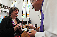 In a short midday service of worship, Michaela Mahler prepares for the imposition of ashes from First United Methodist Church pastor Jim Luther. Ash Wednesday is the first day of Lent in the Western Christian Church, marked by services of penitence. Mahler is from Edina, Minnesota, and is visiting relatives in Salinas.