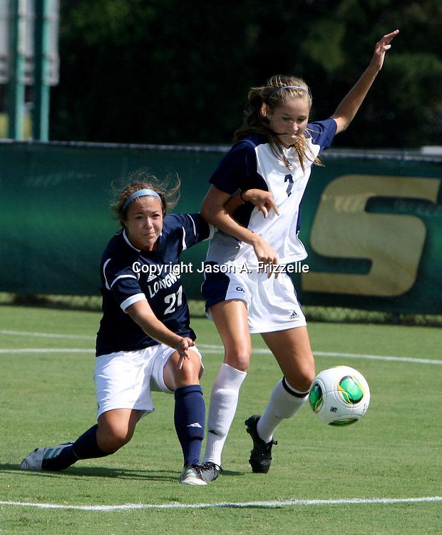 UNCW's Caroline McClain battles Longwood's Chelsea Walter for the ball.