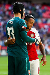 Theo Walcott and Petr Cech of Arsenal celebrate after winning the penalty shootout to lift the Community Shield - Rogan Thomson/JMP - 06/08/2017 - FOOTBALL - Wembley Stadium - London, England - Arsenal v Chelsea - FA Community Shield.