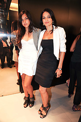 Left to right, LAUREN MILLS and YASMIN MILLS at a party to celebrate the launch of Bang a new male fragrance by Marc Jacobs held at the Fith Floor Restaurant, Harvey Nichols, Knightsbridge, London on 22nd July 2010.