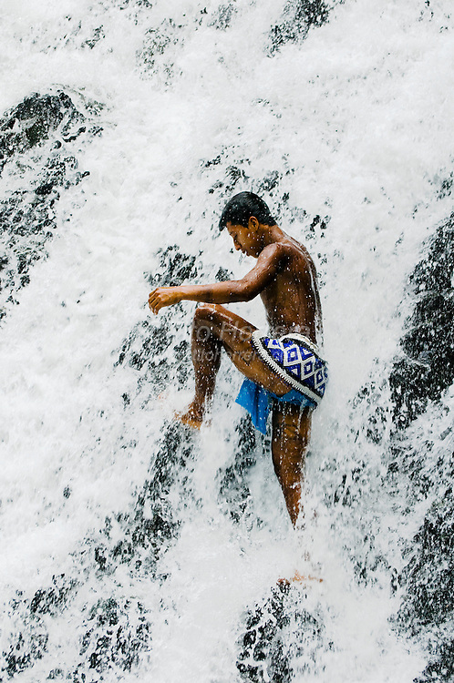 A young emberá in the Chagres falls.  The Emberás are one of the seven indigenous groups still present in Panama.  They are usually find by the Chagres River in the Panama Canal protected areas as well as in the mountains and rivers of the Darien jungle