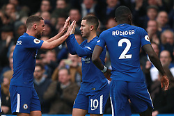 Chelsea's Eden Hazard (centre) celebrates scoring his side's first goal of the game