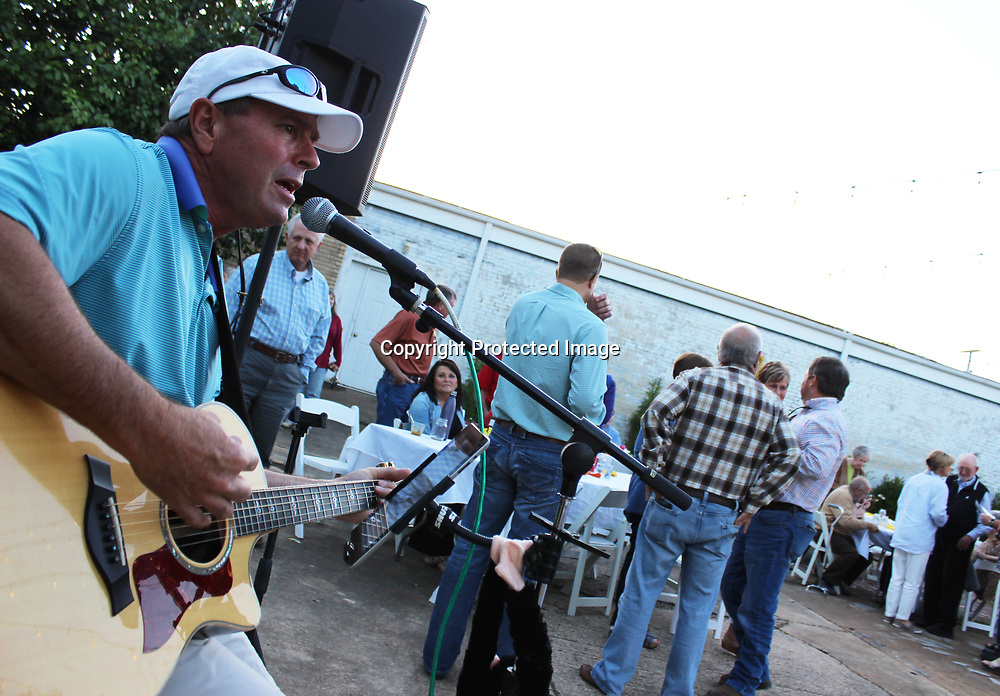 RAY VAN DUSEN/BUY AT PHOTOS.MONROECOUNTYJOURNAL.COM<br /> Class of 65 member Jerry Beard of Columbus plays cover songs to provide entertainment for Thursday's Aberdeen Main Street Dollars for the Depot fundraiser. Mary-Miller Wright also lent her voice as part of the entertainment, and Sam Jaynes was honored for his dedication to the renovation of the depot. More than 120 people supported the event at farmers market plaza.