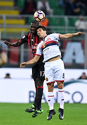 MILAN, March 19, 2017  AC Milan's Christian Zapata (L) vies with Genoa's Giovanni Simeone during a Serie A soccer match between AC Milan and Genoa, in Milan, Italy, March 18, 2017. AC Milan won 1-0. (Credit Image: © Alberto Lingria/Xinhua via ZUMA Wire)