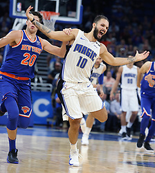 November 8, 2017 - Orlando, Florida, U.S. - The Orlando Magic's EVAN FOURNIER (10) yells as he is fouled by the New York Knicks' DOUG MCDERMOTT, left, at the Amway Center. (Credit Image: © Stephen M. Dowell/TNS via ZUMA Wire)