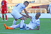 Lyle Taylor of AFC Wimbledon celebrates with goal scorer Tom Elliott of AFC Wimbledon,  during the Sky Bet League 2 match between York City and AFC Wimbledon at Bootham Crescent, York, England on 24 October 2015. Photo by Stuart Butcher.