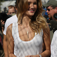 Rosie Huntington-Whiteley enters the Sprint Cup garage area prior to the Daytona 500 at Daytona International Speedway.at Daytona International Speedway on February 20, 2011 in Daytona Beach, Florida. (AP Photo/Alex Menendez)