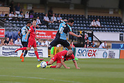 Russell Penn tackles SamWood during the Sky Bet League 2 match between Wycombe Wanderers and York City at Adams Park, High Wycombe, England on 8 August 2015. Photo by Simon Davies.