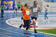 Chorzow, Poland - 2018 June 12: (R) Athletics Technical Delegate Janusz Rozum and (L) former athlete Zuzanna Radecka run in special relay 4 x 100m while athtletics competition during National Special Olympics Games 2018 at Slaski Stadium on June 12, 2018 in Chorzow, Poland.<br /> <br /> Adam Nurkiewicz declares that he has no rights to the image of people at the photographs of his authorship.<br /> <br /> Picture also available in RAW (NEF) or TIFF format on special request.<br /> <br /> Any editorial, commercial or promotional use requires written permission from the author of image.<br /> <br /> Image can be used in the press when the method of use and the signature does not hurt people on the picture.<br /> <br /> Mandatory credit:<br /> Photo by © Adam Nurkiewicz / Mediasport