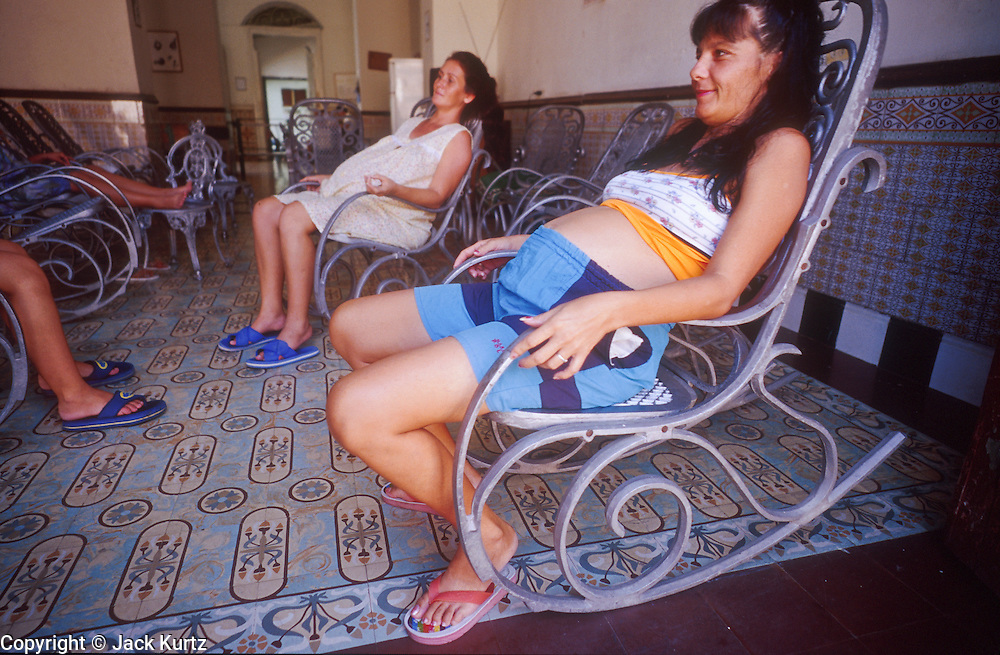 23 JULY 2002 - TRINIDAD, SANCTI SPIRITUS, CUBA: Pregnant women in a Hogar de Maternidad (Maternity Home) in the colonial city of Trinidad, province of Sancti Spiritus, Cuba, July 23, 2002. Trinidad is one of the oldest cities in Cuba and was founded in 1514. The Cuban government has maternity homes across the island. Women late in their pregnancy or experiencing a difficult pregnancy, live in the homes close to medical help until their delivery date. .PHOTO BY JACK KURTZ