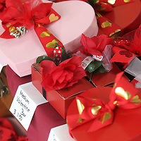 Boxes for Valentine's Day are stocked on the shelf with chocolate sweets at Simply Sweet by Margarete in Tupelo.