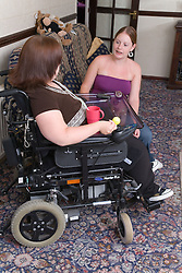 Woman with a disability chatting to non disabled friend,