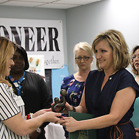 RAY VAN DUSEN/BUY AT PHOTOS.MONROECOUNTYJOURNAL.COM<br /> Pioneer Community Hospital of Aberdeen 2017 Daisy Award winner Jennifer Alexander, right, accepts a Shona sculpture entitled A Healer's Touch from chief nursing officer Ellen Ratliff during a ceremony Friday to wrap up National Hospital Week.