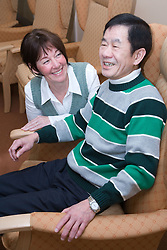 Older man and carer in a care home,