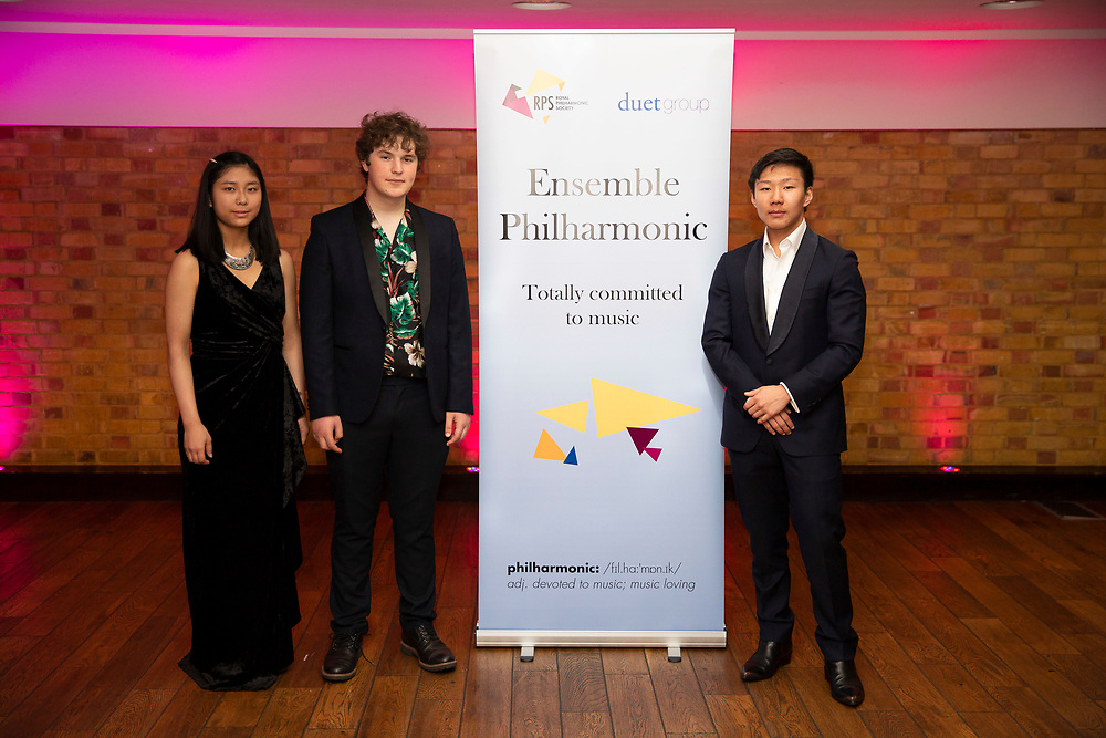 Composer Adam Possener, Marie Sato (flute) and Noah Zhou (piano), winners of the 2018 RPS Duet Prizes for young instrumentalists and composers<br /> Photo credit required:  Simon Jay Price