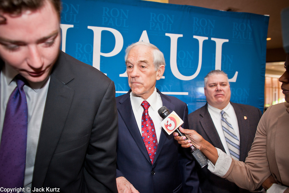 22 FEBRUARY 2012 - MESA, AZ:  Congressman RON PAUL is led away from reporters before a fundraiser in Mesa, AZ, Wednesday. Congressman Paul is participating in the CNN debate in Mesa, AZ, later Wednesday night. He has several fundraisers scheduled in Mesa before the debate.     PHOTO BY JACK KURTZ