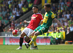 Memphis Depay of Manchester United (L) and Ivo Pinto of Norwich City in action - Mandatory by-line: Jack Phillips/JMP - 07/05/2016 - FOOTBALL - Carrow Road - Norwich, England - Norwich City v Manchester United - Barclays Premier League
