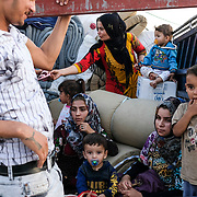 DOHUK, IRAQ - OCTOBER 24: A family from Qamishli, Syria arrives at Badarash IDPs camp which has continued to swell for Syrian Kurdish refugees fleeing the recent Turkish incursion in Rojava. In seven days UNHCR reports that 7,100 have now arrived on October 24, 2019 in Dohuk, Iraq. Many fleeing have said saying they paid to be smuggled through the Syrian border.  (Photo by Byron Smith/Getty Images)