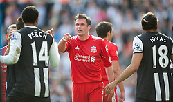 NEWCASTLE-UPON-TYNE, ENGLAND - Sunday, April 1, 2012: Liverpool's Jamie Carragher argues with Newcastle United's James Perch during the Premiership match at St James' Park. (Pic by David Rawcliffe/Propaganda)