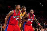 15 January 2010: Forward's Marcus Camby and Rasual Butler of the Los Angeles Clippers box out Andrew Bynum of the Los Angeles Lakers during the second half of the Lakers 126-86 victory over the Clippers at the STAPLES Center in Los Angeles, CA.