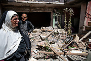 9 August 2018 – Mosul – Iraq – A family stands amongst the ruins of their home in the Bab al-Jaded neighborhood of Ghizlani, West Mosul, which was hit by a rocket in March 2017. <br /> <br /> This home is amongst the houses due to be rehabilitated in West Mosul with the support of UNDP's Funding Facility for Stabilization (FFS). <br /> <br /> © UNDP Iraq / Claire Thomas