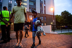 **NOTE TO EDITORS: Young children are pictured**<br /> &copy; Licensed to London News Pictures. 23/06/2017. London, UK. Residents being evacuated from the Taplow block of the Chalcots Estate in Camden after it failed a fire inspection because of combustable cladding. Prime Minister Theresa May has told Parliament that up to 600 high rise tower blocks may have similar cladding to that found in Grenfell Tower, which went on fire last week, in which as many as 79 residents are thought to have perished Photo credit: Ben Cawthra/LNP