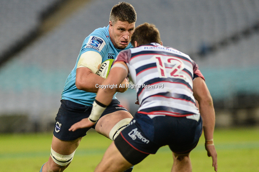 25.04.2015.  Sydney, Australia. Super Rugby. NSW Waratahs versus Melbourne Rebels. Waratahs lock Mitchell Chapman takes on Rebels centre Mitch Inman. The Waratahs won 18-16.