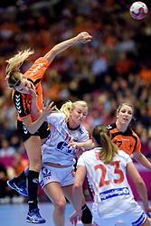 20-12-2015 DEN: World Championships Handball 2015 Nederland - Noorwegen, Herning<br /> Finale WK Handbal / Nederland verliest kansloos de finale van Noorwegen en moet genoegen nemen met zilver / Stine Oftedal #10 of Norway zet de hand op de keel van Sanne van Olphen #9 bij haar doelpoging